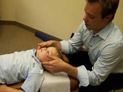 Chiropractor Bart Conn adjusting child